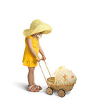 A little girl with doll carriage. Isolated on a white Stock Images