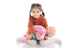 The little girl with a doll isolated on a white Royalty Free Stock Photography