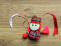 Little girl doll made as martisor with red and whi Royalty Free Stock Photos