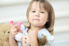 Little girl with doll playing happy smiling. Little girl with doll playing happy Royalty Free Stock Images