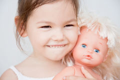 Little girl with a doll royalty free stock photo