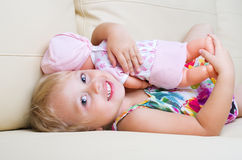 Little girl with doll Stock Image