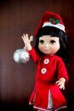 Little girl doll. Wearing Santa's hat Royalty Free Stock Photos