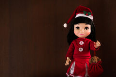 Little girl doll. Wearing Santa's hat Royalty Free Stock Photography