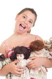 Little girl with dolls Stock Images