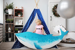 Little girl and dolphin Stock Photography