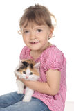 Little girl with domestic kitten Stock Photos