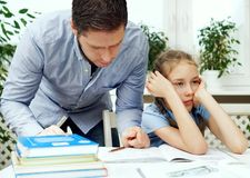 Father helping daughter. Royalty Free Stock Photos