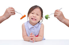 Little girl don't want to eat vegetables stock photography