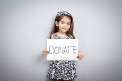 Little girl with donations sign.  Stock Image