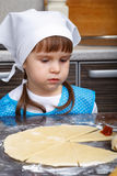 Little girl with a dough stock photography