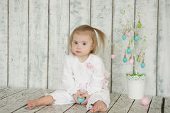 Little Girl with Down syndrome is holding Easter eggs Stock Photo