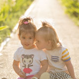Little girl with Down syndrome playing with her girlfriend. Little girl  with Down syndrome playing with her girlfriend Royalty Free Stock Images