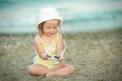 Little girl with Down  syndrome playing sunglasses on the beach. Little girl with Down syndrome playing sunglasses on the beach Royalty Free Stock Photo