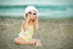 Little girl with Down  syndrome wore glasses and poses faces Royalty Free Stock Photography