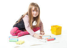 Little girl draw with chalks Royalty Free Stock Photos