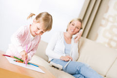 Little girl draw with color pencil in lounge Royalty Free Stock Photos