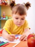 Little girl draw with felt-tip pen. Cute little girl draw with felt-tip pen in preschool stock photos