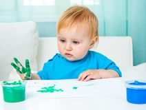 Little girl draw finger paints Royalty Free Stock Photography
