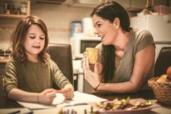 Little girl draw, mom help her. Close up. Little girl draw, mom help her. Mother and daughter at home.Close up royalty free stock image