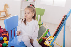 Little girl draw in room Stock Photos