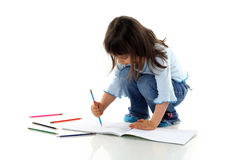 Little girl is drawing Royalty Free Stock Images