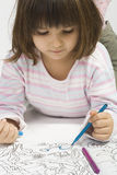 Little girl drawing Stock Photo