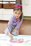 Little girl drawing Royalty Free Stock Image