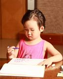Little girl drawing Royalty Free Stock Photography
