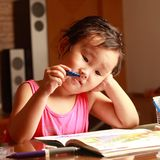 Little girl drawing Stock Images