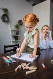 Girl drawing in album Stock Image