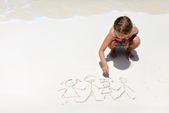 Little girl drawing at beach Royalty Free Stock Image
