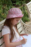 Little girl is drawing Royalty Free Stock Photos