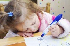 Little girl drawing beetle Stock Photography