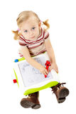 Little girl drawing on a board Royalty Free Stock Photos