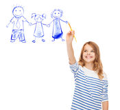 Little girl drawing with brush family portrait. Education, school and imaginary screen concept - cute little girl drawing with brush family portrait Stock Image