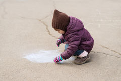 Little girl drawing with a chalk Royalty Free Stock Photo