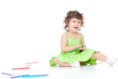 Little girl drawing with color pencils Royalty Free Stock Photos