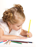 Little girl  drawing with colored pencils Stock Photos