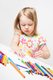 Little girl drawing with colourful pencils. Cute little girl drawing with colourful pencils and markers stock images
