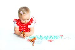 Little girl drawing with crayons Royalty Free Stock Photos