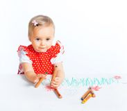 Little girl drawing with crayons Stock Photo