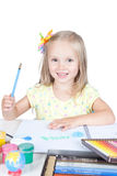 Little girl drawing at the desk Stock Photo