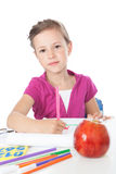 Little girl drawing at the desk Royalty Free Stock Photography