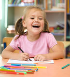Little girl is drawing with felt-tip pen. Cute little girl is drawing with felt-tip pen in preschool royalty free stock photo