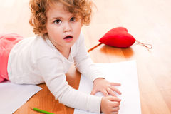 Little girl drawing on the floor Stock Photo