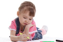 Little girl drawing on floor Royalty Free Stock Images