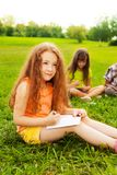 Little girl drawing with friends Stock Images