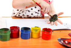 Little Girl Drawing On Her Hand Stock Photography
