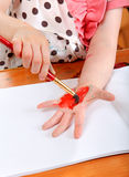 Little Girl Drawing On Her Hand Stock Photo